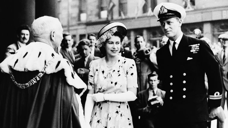 Prince Elizabeth and her fiancé, Lt. Philip Mountbatten are welcomed on July 16, 1947 at Usher Hall, Edinburgh, Scotland, by Sir John Falconer, Lord Provost of Edinburgh (back to camera).    Princess Elizabeth was granted the Freedom of Edinburgh at an official ceremony.   (AP Photo)