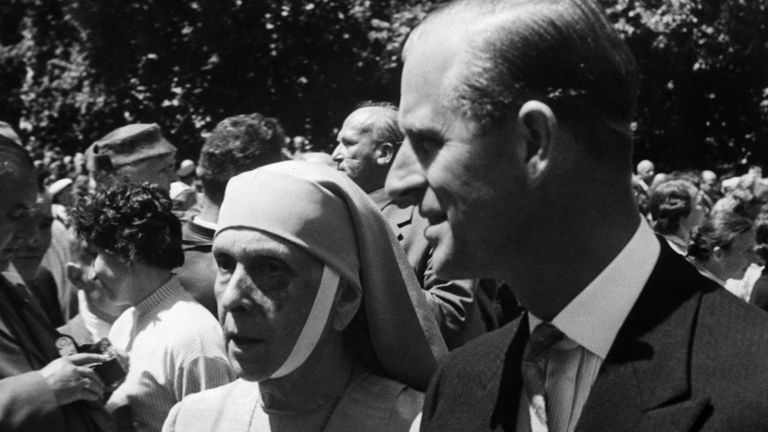 Britain's Prince Philip escorts his mother, Princess Alice Andreeas of Greece, in wedding procession of Princess Margarita of Baden and Prince Tomislav of Yugoslavia after the religious ceremonies on June 5, 1957 at Salem, Germany.    Margarita is a niece of Philip. (AP Photo)