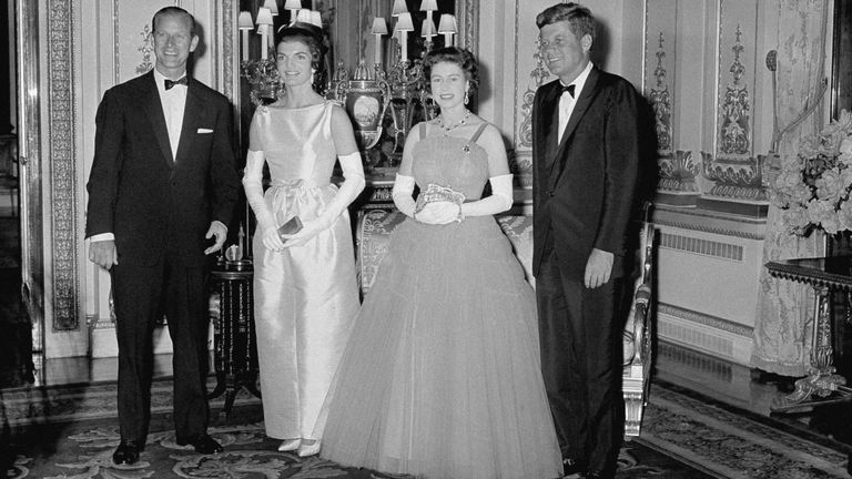 Prince Philip, Jacqueline Kennedy, and Queen Elizabeth II listen to President John Kennedy at Buckingham Palace in London on June 5, 1961. The Kennedys were the guests of the Queen and Prince at dinner. (AP Photo)