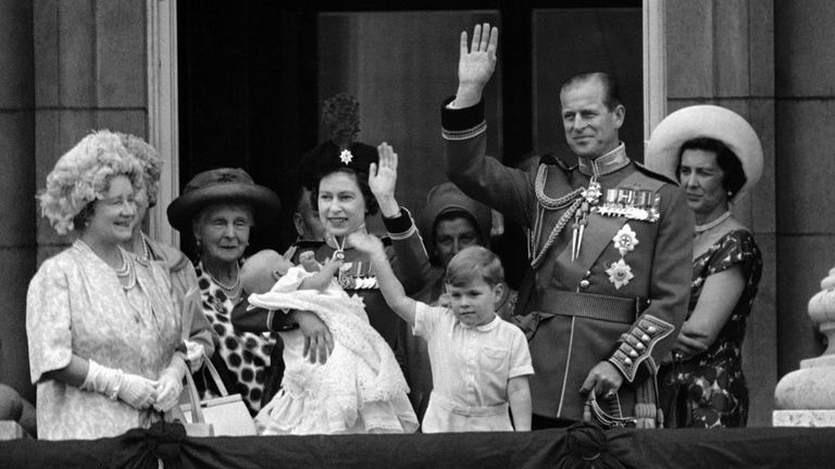 Holding 12-week-old Prince Edward, Queen Elizabeth II waves to the crowds outside Buckingham Palace in London on June 13, 1964, after the traditional Trooping the Colour ceremony at nearby Horse Guards Parade. With her are ...Prince Philip and their four-year-old son Prince Andrew. The ceremony marked the Queen...s official birthday, her 38th. Her actual birthday was April 21, when Britain is considered too rainy for outdoor ceremonies. (AP Photo)