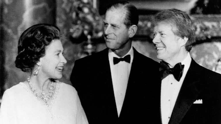 President Jimmy Carter, right, poses with Queen Elizabeth II and Prince Philip, May 7, 1977, at Buckingham Palace prior to the State Dinner for Carter and six other heads of state. (AP Photo/OBPA)