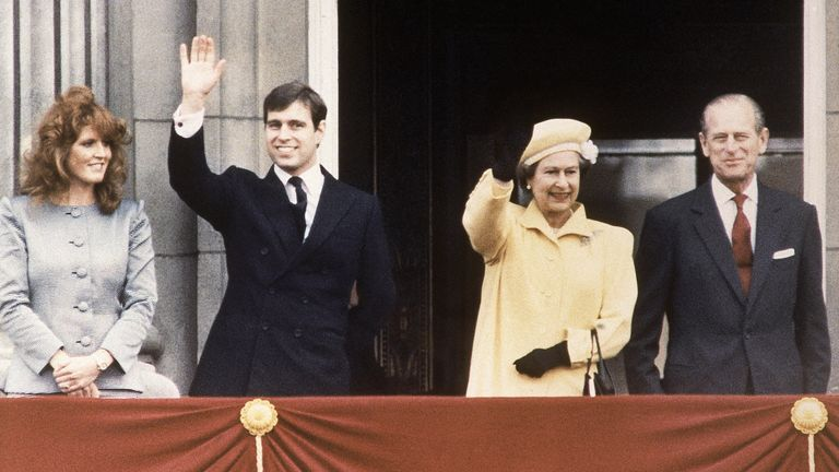 On the balcony of Buckingham Palace, London on April 21, 1986, Queen Elizabeth II and her husband Prince Philip (right) are joined by one of  their sons Prince Andrew and his fianc?e Sarah Fergusson on the occasion of the Queen's 60th birthday celebration. (AP Photo/Peter Kemp)