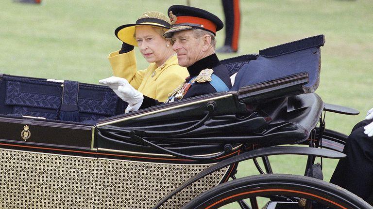 Shown in photo is Queen Elizabeth II with husband shown in June 1991. (AP Photo)