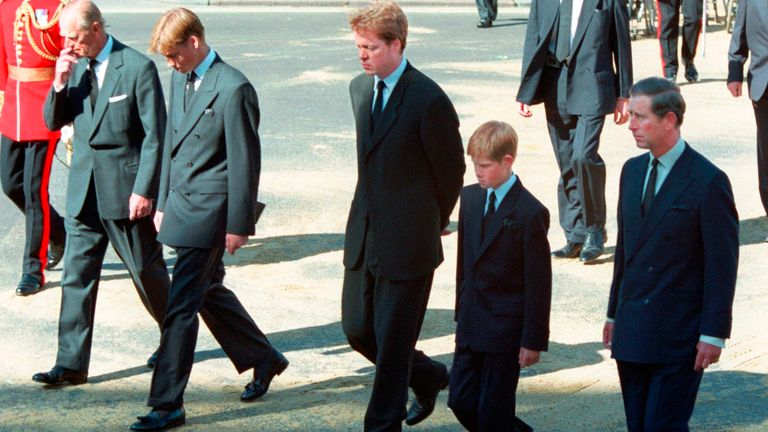 FILE - In this Saturday Sept. 6, 1997 file photo, from left Prince Philip, Prince William, Earl Spencer, Prince Harry and Prince Charles follow the coffin of Diana, Princess of Wales along Horse Guards Parade toward Westminster Abbey, London. Long dismissed as a party boy, Prince Harry has transformed himself in the public eye and enjoys widespread popularity as he prepares to marry Meghan Markle on May 19, 2018. Harry has become a forceful advocate for veterans and won admiration by speaking op