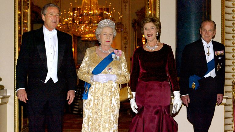 U.S. President George W. Bush, left, and first lady Laura Bush, second right,  stand with Britain's Queen Elizabeth II and Prince Philip, the Duke of Edinburgh for an official photo in the Music Room before the start of the State Banquet at Buckingham Palace in London Wednesday, Nov. 19, 2003. Bush is making a four-day state visit to Britain. (AP Photo/Charles Dharapak)