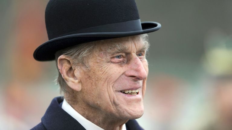 Britain's Prince Philip smiles during his visit at the armored regiment of the Queen's Royal Hussars in Paderborn, Germany, Wednesday, Nov. 19, 2014. He awarded the soldiers who just returned from south Afghanistan for their service. (AP Photo/dpa, Caroline Seidel)