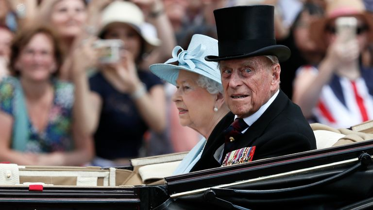 Britain's Queen Elizabeth II and Prince Philip, the Duke of Edinburgh return to Buckingham Palace in a carriage, after attending the annual Trooping the Colour Ceremony in London, Saturday, June 17, 2017. (AP Photo/Kirsty Wigglesworth)