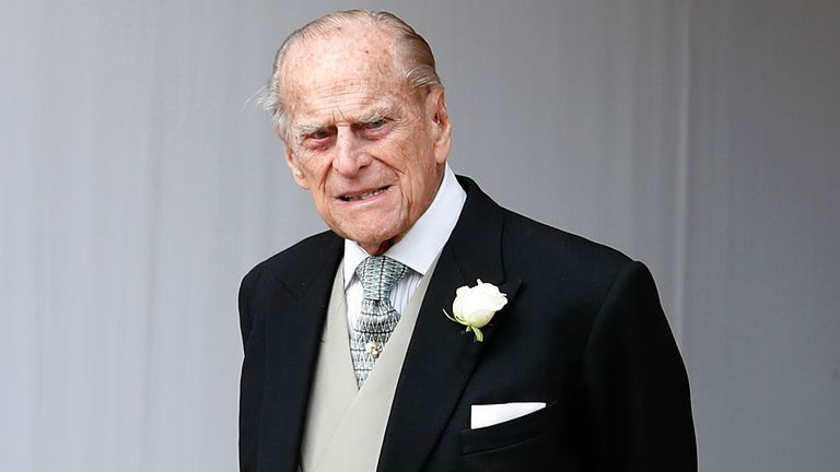 Britain's Prince Philip waits for the bridal procession following the wedding of Princess Eugenie of York and Jack Brooksbank in St George's Chapel, Windsor Castle, near London, England, Friday, Oct. 12, 2018. (AP Photo/Alastair Grant, Pool)