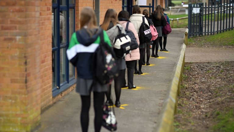 Pupils at a secondary school wait to get tested for COVID-19