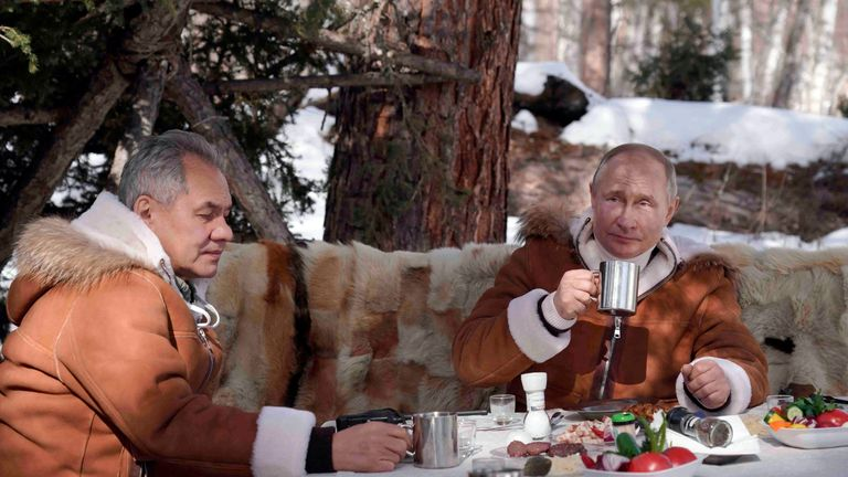 Russian President Vladimir Putin, right, and Russian Defense Minister Sergei Shoigu have a meal and drinks. Pic: AP