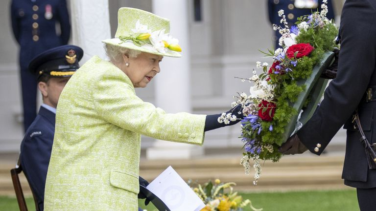 Queen Elizabeth II inspects a wreath during a service to mark the Centenary of the Royal Australian Air Force at the CWGC Air Forces Memorial in Runnymede, Surrey. Picture date: Wednesday March 31, 2021.
