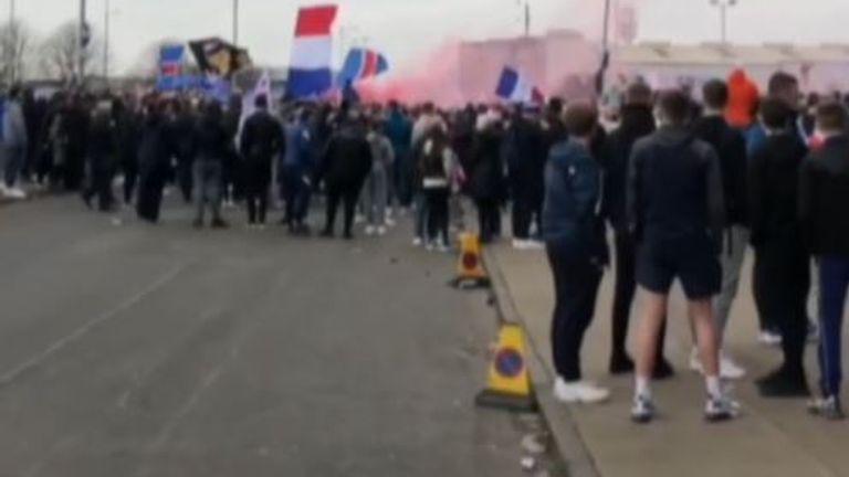 Fans congregate outside Ibrox stadium