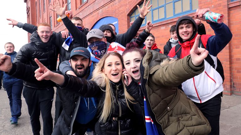 Rangers fans celebrate the possibility of winning the Premier League title