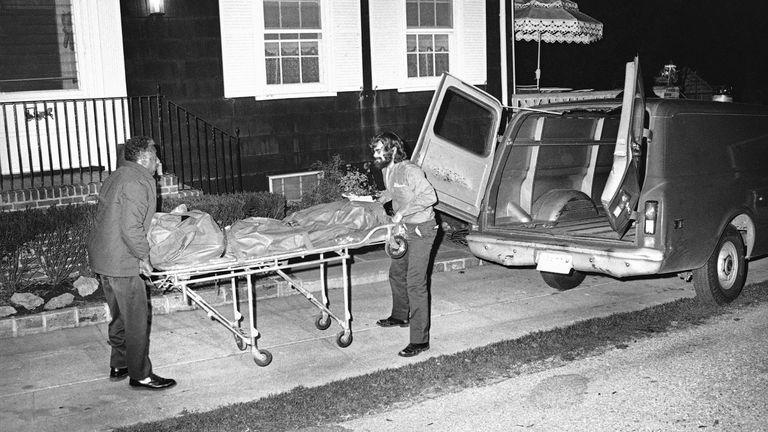 """This was the scene on New York's Long Island at night on Wednesday, Nov. 14, 1974 in Amityville, N.Y. at the house where the six bodies of the Ronald DeFeo family were found slain. The Suffolk Country Sheriff is investigating the slayings at the DeFeo house named """"High Hopes."""" (AP Photo/RED)"""