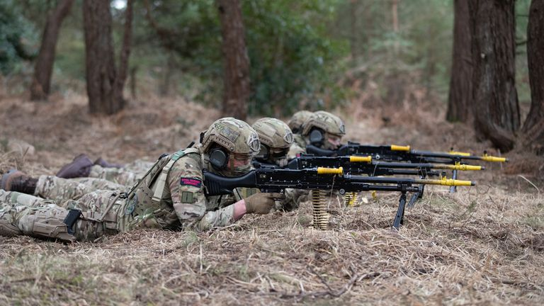 Royal Marines Commandos prepare to give covering fire by machine gun as during a live exercise demonstration at Bovington Camp in Dorset. Picture date: Friday March 19, 2021. PA Photo. See PA story DEFENCE Review. Photo credit should read: Andrew Matthews/PA Wire