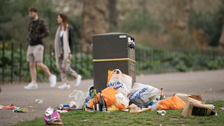 Bins overflow with rubbish in Battersea Park in south London