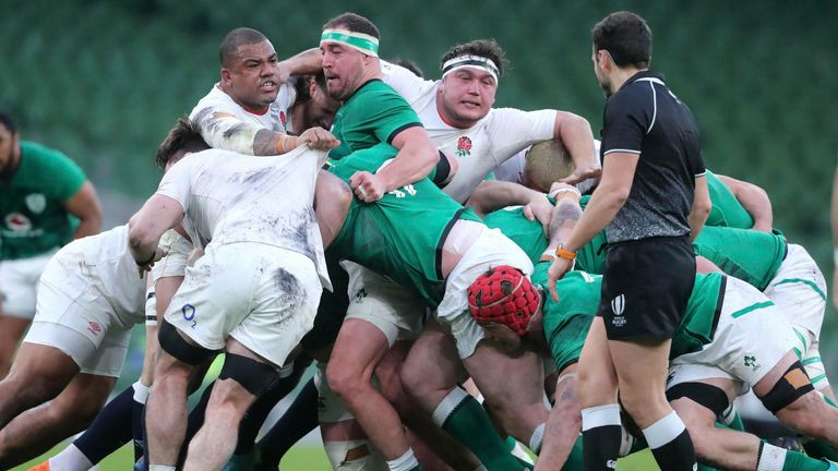Ireland and England players compete in the scrum during the recent Six Nations game in Dublin. Pic: AP