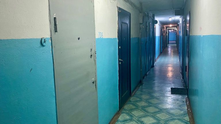 The blue building and blue corridor are Leningradsky Proskpekt, Kemerovo where the murder happened.  In flat 738.
