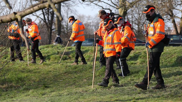 Volunteers from London Search and Rescue near Eagle Pond on Clapham Common