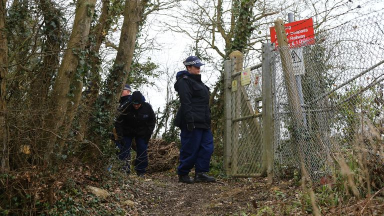 Police officers search woodland near to Great Chart Golf and Leisure country club and course in Ashford, Kent
