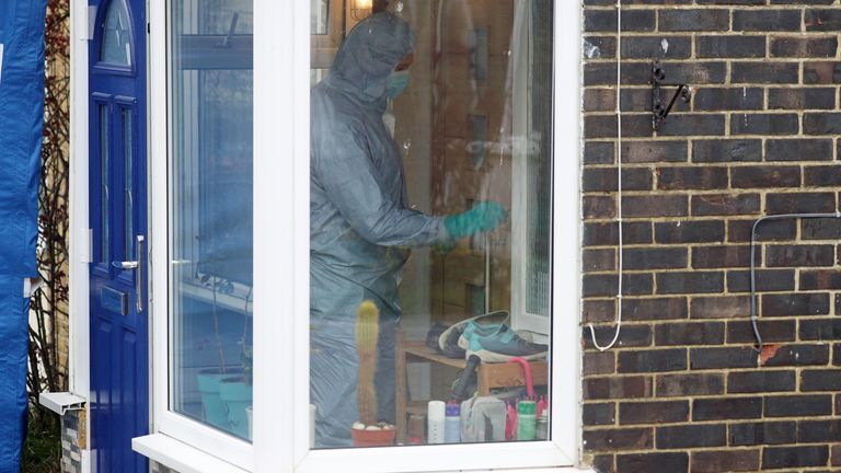 A forensic officer inside the house in Freemens Way in Deal, Kent