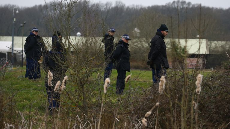 Land near Great Chart Golf and Leisure country club and course in Ashford, Kent, is searched by police officers