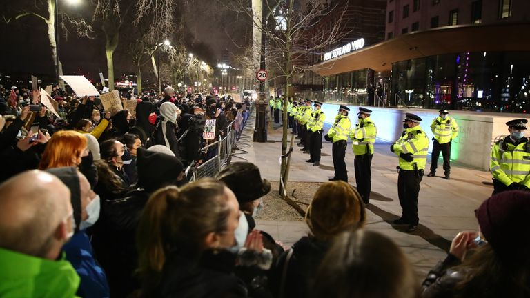 Police face protesters outside New Scotland Yard