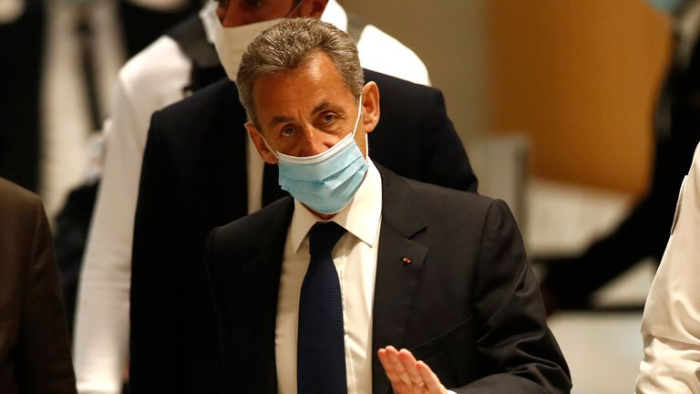 Former French President Nicolas Sarkozy leaves the Paris courtroom on Monday. Pic: AP