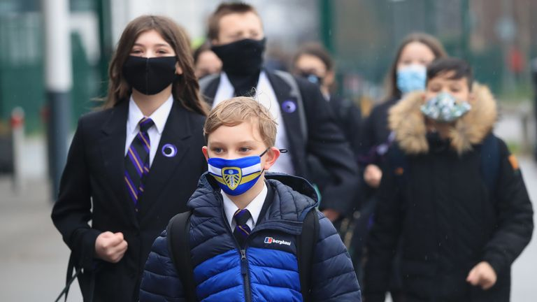 Children arrive at Outwood Academy in Woodlands, Doncaster, as pupils in England return to school