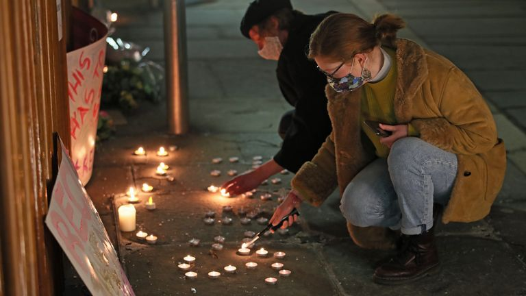 People light candles outside the Scottish Parliament after the Reclaim These Streets vigil for Sarah Everard in Edinburgh was cancelled.