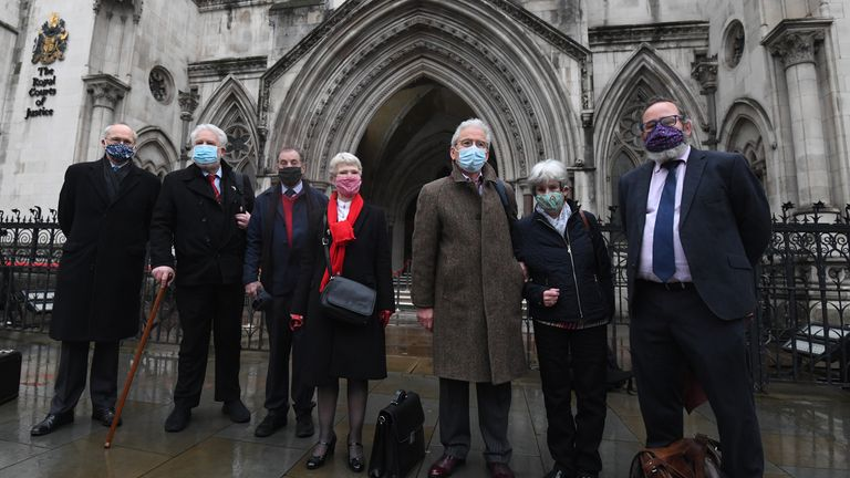 "Mark Turnbull, Terry Renshaw, Harry Chadwick, Eileen Turnbull, John McKinsie Jones with wife Rita McKinsie Jones and lawyer Jamie Potter, outside the The Royal Courts Of Justice, London, ahead of a hearing in the Court of Appeal for the so-called ""Shrewsbury 24"". 14 members are attempting to overturn their convictions for offences incurred whilst picketing building sites in Shrewsbury in the 1972 national builders' strike. Picture date: Wednesday February 3, 2021."