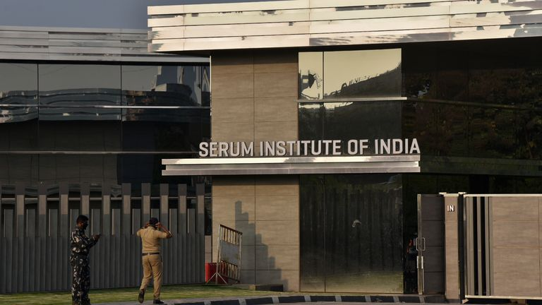 Policemen guard outside the headquarters of the Serum Institute of India in Pune