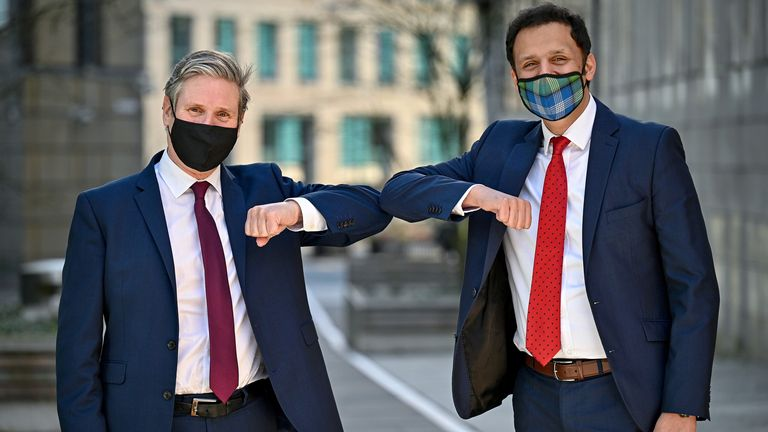 Labour leader Keir Starmer and Scottish Labour Leader Anas Sarwar meet staff outside a vaccine centre in Edinburgh