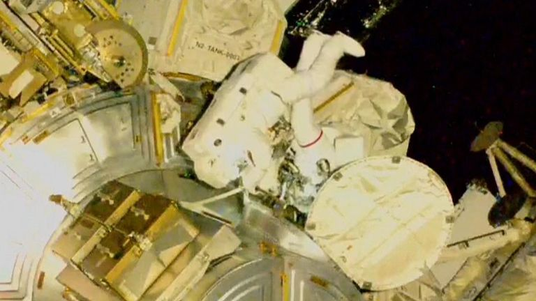 NASA astronauts conduct a spacewalk