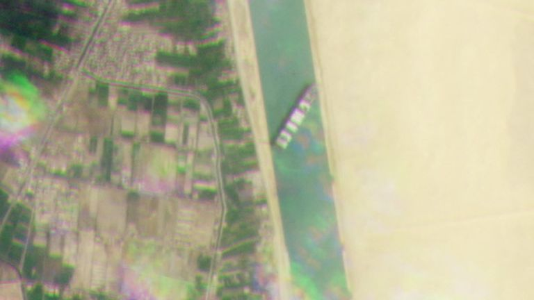 A satellite image shows the Ever Given stranded in the Suez Canal. Pic: Planet Labs Inc via Reuters