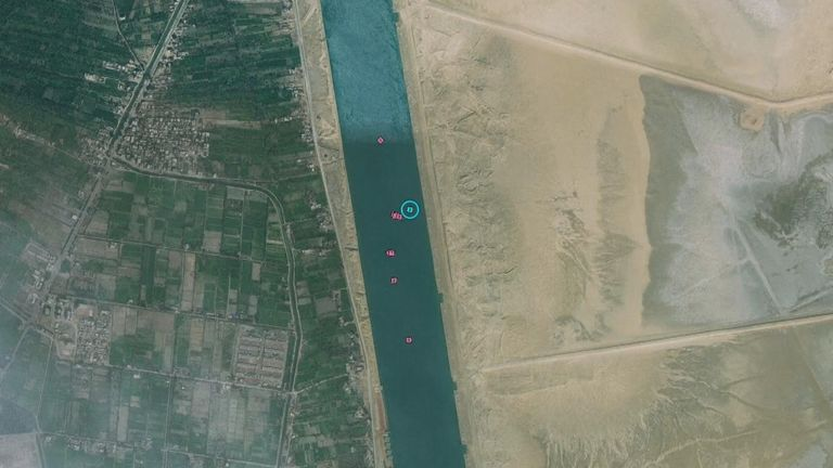 A graphic shows the stranded ship after its partial refloating in Suez Canal