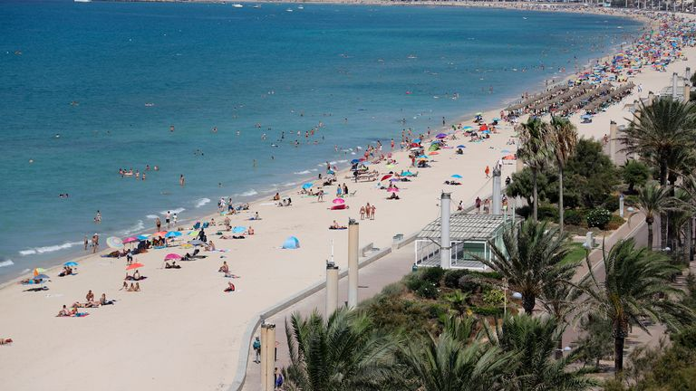 Sun seekers on a beach in Palma, Majorca last August. Pic: AP