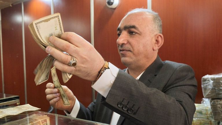 Walid, known as 'the sheikh' says '$10 used to give you 500 Syrian Lira. Now $10 is 40,000 Syrian Lira'