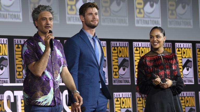 Taika Waititi, Chris Hemsworth and Tessa Thompson are all returning to the film. Pic: Chris Pizzello/Invision via AP