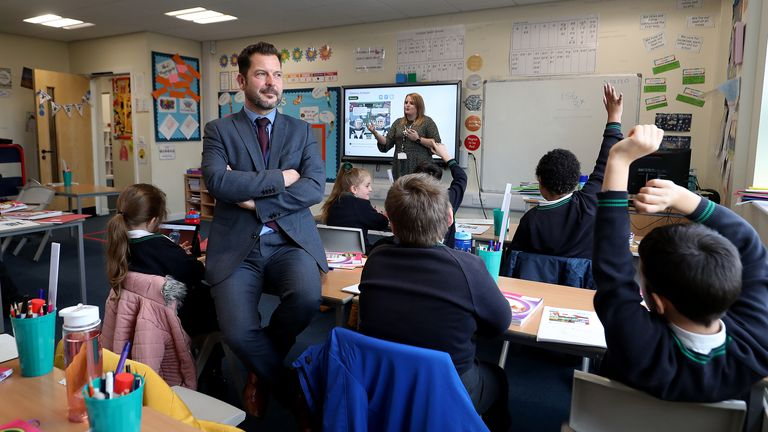 Simon Cotterill, head teacher of Manor Park School and Nursery in Knutsford, Cheshire, sits in a classroom