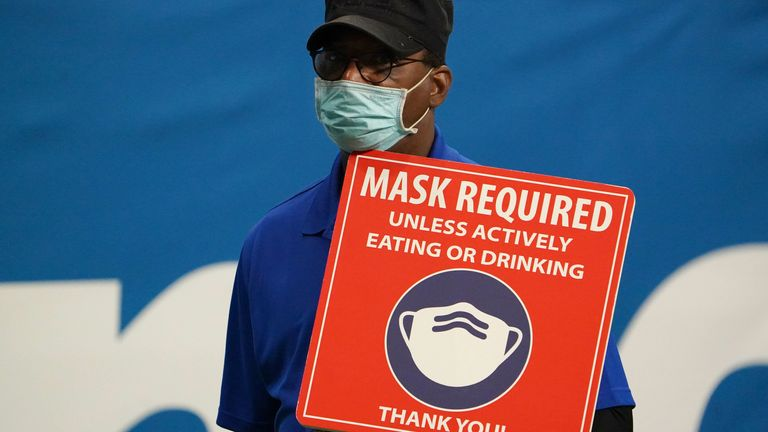Dec 29, 2020; San Antonio, TX, USA; A worker holds a Mask required sign during the Alamo Bowl between the Colorado Buffaloes and the Texas Longhorns at the Alamodome. Mandatory Credit: Kirby Lee-USA TODAY Sports