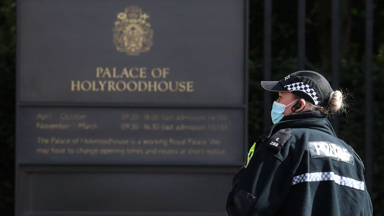 Police officers conduct a search within the grounds of the Palace of Holyroodhouse in Edinburgh. A man was arrested after a bomb disposal team attended a report of a suspicious item in the grounds of the Queen's official residence in Edinburgh. Picture date: Wednesday March 24, 2021.
