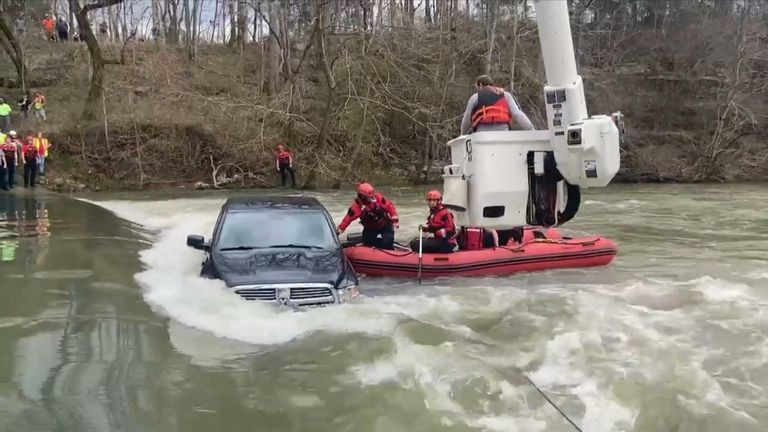 Five rescued from truck trapped by flood