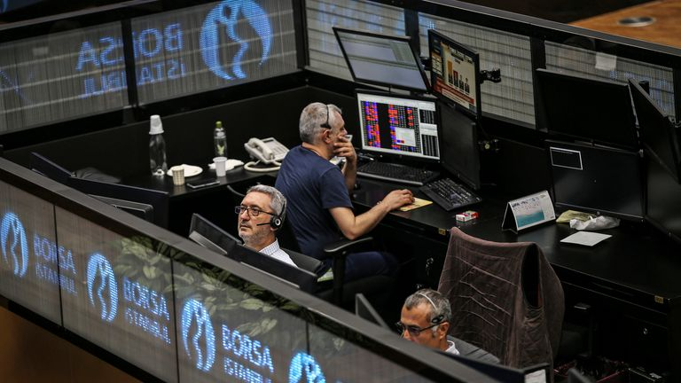 A day after elections, traders work at the Borsa Istanbul (BIST) stock exchange shortly after its opening, in Istanbul, Monday, June 25, 2018. Pic: AP