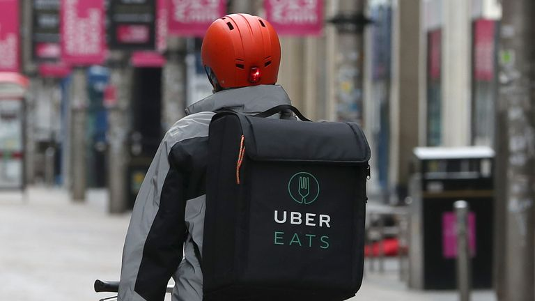 An UBER EATS cyclist in Glasgow as the UK continues in lockdown to help curb the spread of the coronavirus. 28/3/2020