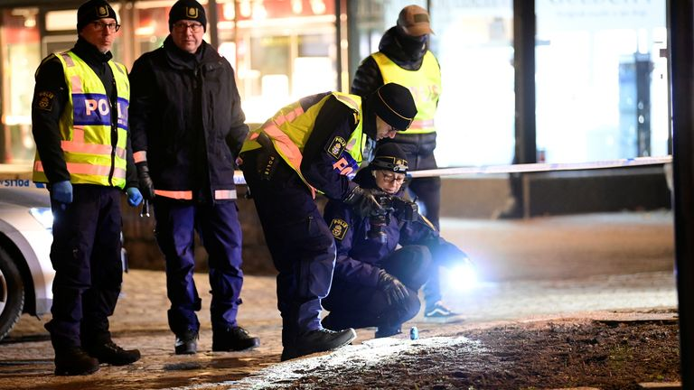 Police forensics team members work at a knife attack site where several people were injured before the suspect was shot by police and taken into custody in Vetlanda, Sweden March 3, 2021