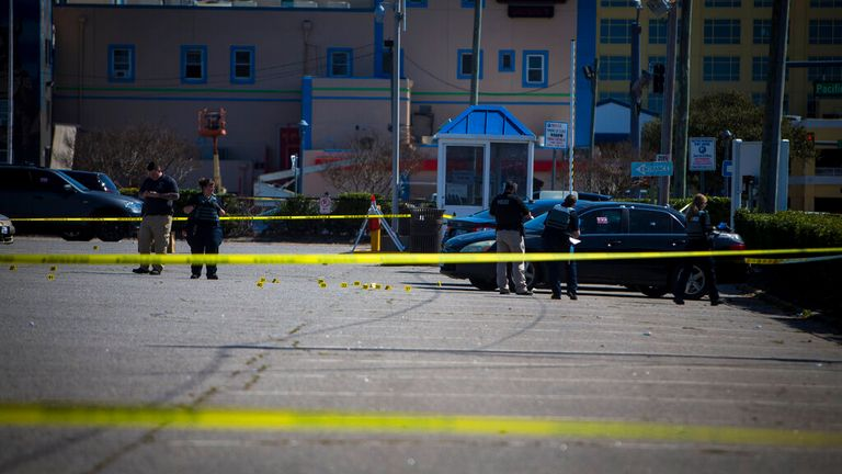 Police officers are investigating the crime scene of the shooting