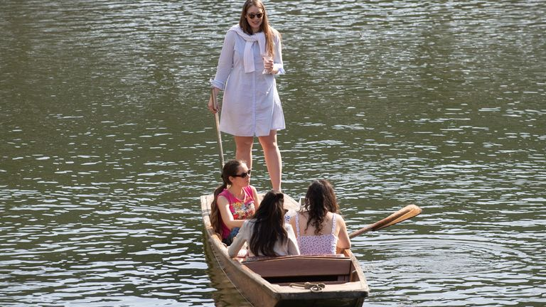People punt along the River Cam in Cambridge. Picture date: Thursday March 18, 2021. Temperatures in parts of the UK are expected to be significantly warmer this week as families and friends are reunited and sporting activities are allowed to resume in England.
