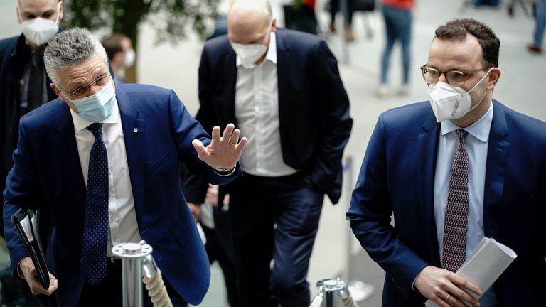 Lothar Wieler (l), President of the Robert Koch Institute and Jens Spahn (CDU,r), Federal Minister of Health, and , arrive for the press conference on the Corona situation before Easter. Photo by: Kay Nietfeld/picture-alliance/dpa/AP Images