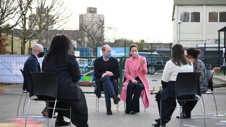 The Duke and Duchess of Cambridge speak with teachers during a visit to a school in Stratford, east London
